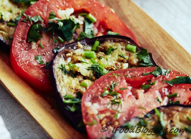 This low calorie marinated eggplant and tomatoes recipe is very easy to make and I am sure you are going to love it. Vegan, low carb, gluten free and paleo friendly, this dish can be served as an appetizer, as a side dish, in place of a salad, or just by itself. It's that good!
