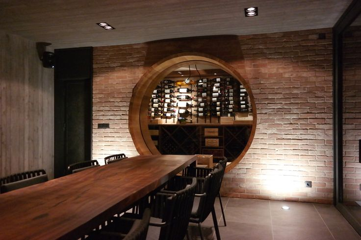party room with a window to the vine cellar