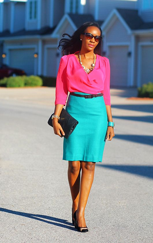 Chic colorblocking in neon pink blouse and turquoise pencil skirt.
