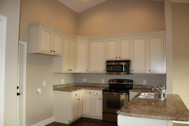 Madura gold granite like ours with vanilla creme painted for Beige painted kitchen cabinets