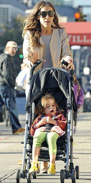 Cute as a button: Parker pushed little Tabitha along in her stroller this morning