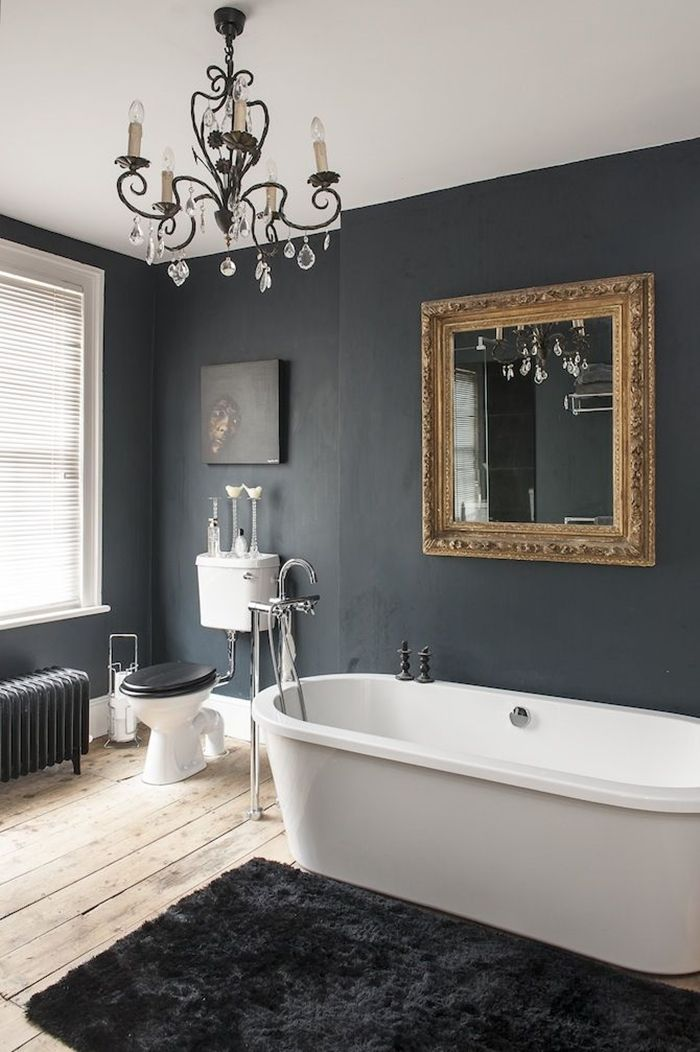 Bathroom Palette: black & white - white bathtub and black wall with golden mirror frame.  [Selection of bathroom images depending on colour shades] ITA: Il bagno in bianco e nero - galleria di immagini