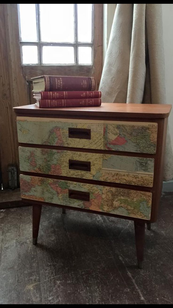 A retro dresser decoupage with old maps.