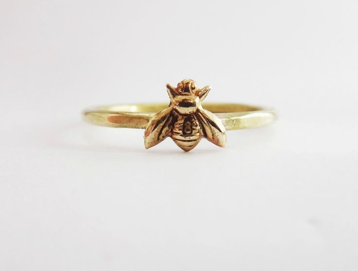 Bee ring, tiny honeybee ring, gold bee ring, gold brass  bee ring, hammered brass bee ring, silver band bee ring, silver band gold bee ring by Lovender on Etsy https://www.etsy.com/listing/186726419/bee-ring-tiny-honeybee-ring-gold-bee