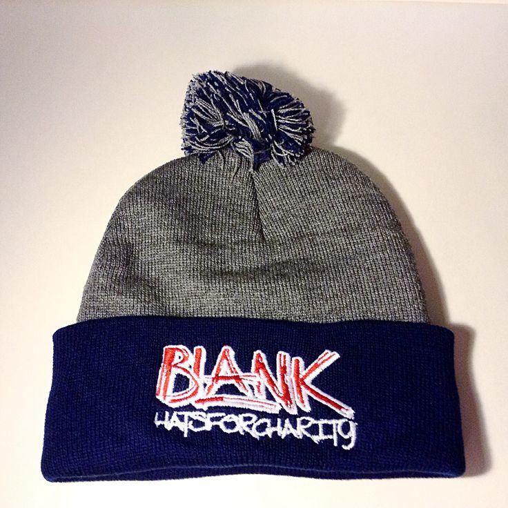 Navy and charcoal Pom Pom toque with a red and white logo