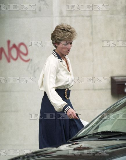 March 11, 1994: Princess Diana leaves the Non-Stop Party shop in Kensington High Street, London.