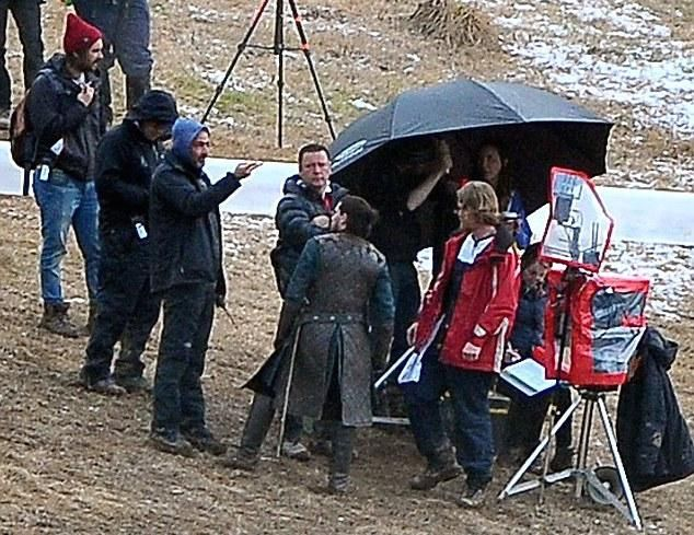 According to new photos from Daily Mail, it appears that Kit Harington, who plays Jon Snow, has been spotted on set in Belfast. With his back turned to the camera, Harington is dressed in full Snow garb -- man bun and all.