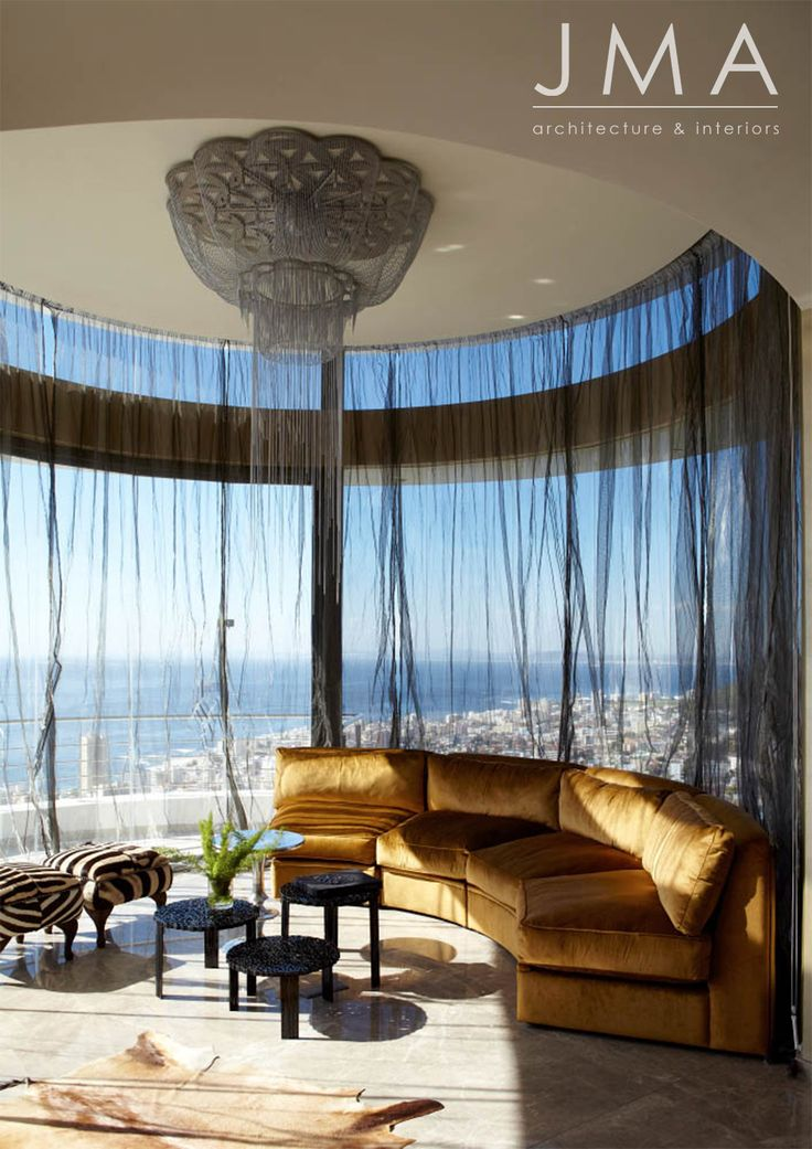 Curved lounge interior with glamorous chandelier.