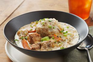 Slow-Cooked Pork Stew with Homemade dumplings made with stuffing mix lend a savory surpise to this warm and creamy slow-cooker pork stew recipe