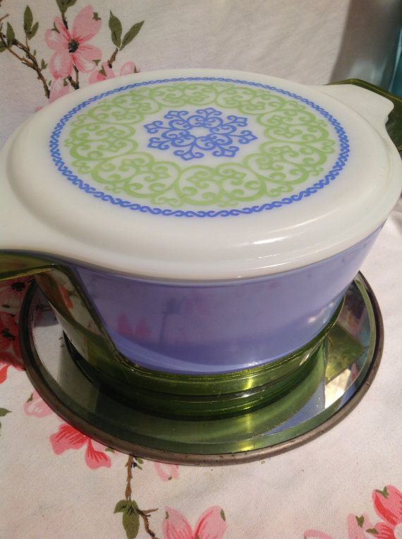 Vintage rare Pyrex Ocean Filigree 475 round bowl casserole with lid and cradle. via Etsy