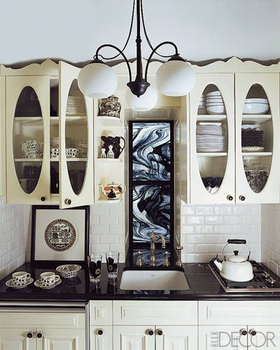 Anna Sui Home New York - The kitchen cabinets by Petrit Coma were inspired by an antique pie safe; the cooktop is by Wolf.