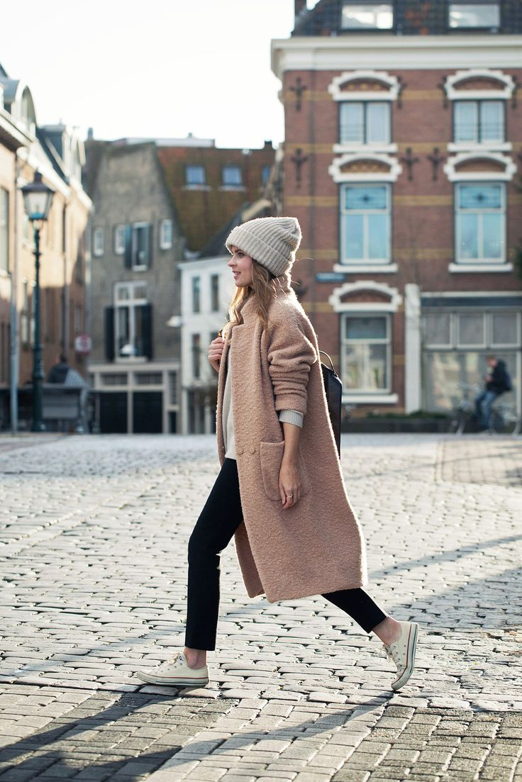Camel coat, grey beanie, black
