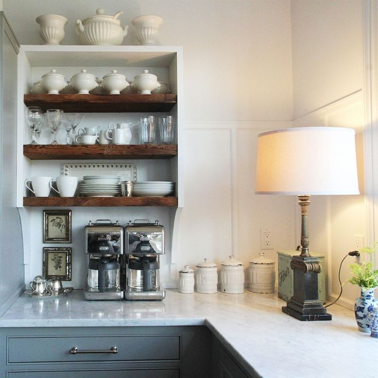 Semi-open kitchen shelving. Rustic wood shelf combined with traditional cabinets.