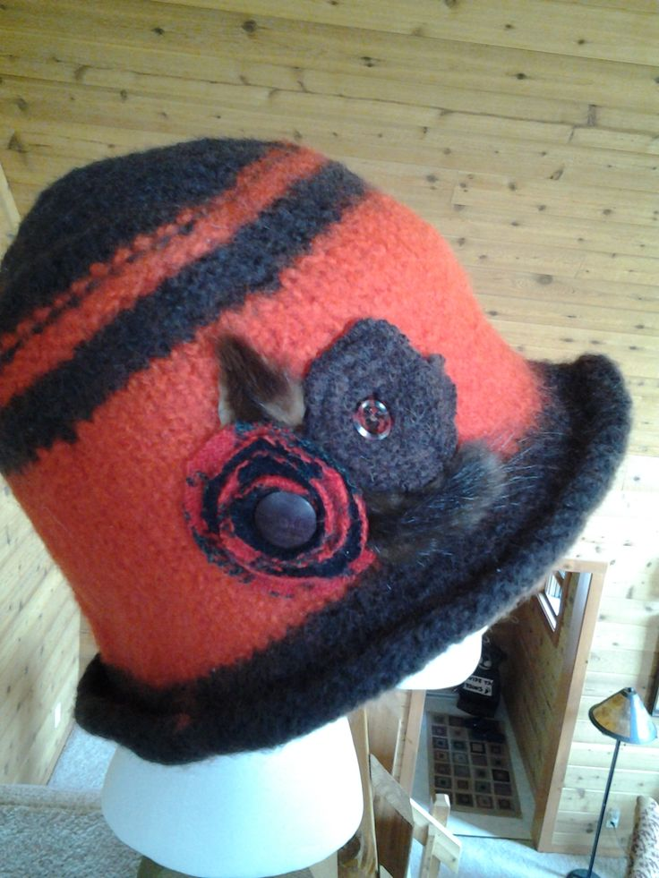 Coral and navy wool!  Added a knit in band to the top for fun!  Hand designed wool flowers with vintage buttons!