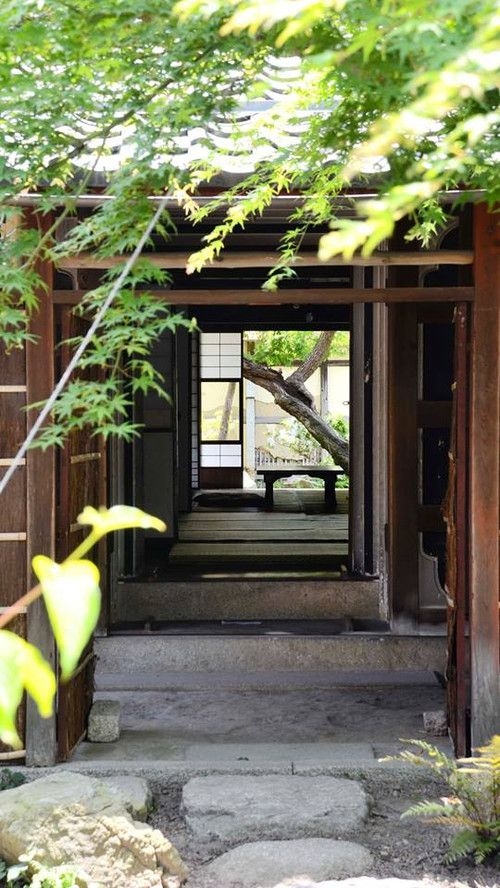 Japanese traditional house Have an open/screened-in room between two sections of a house !