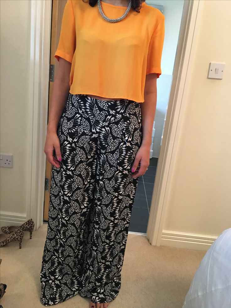 CASUAL Another pair of floaty palazzo trousers. Colour block instead of pairing with white and black to make outfit more thought out and interesting. Great for hot weekends and for the day time. Wear with chunky necklace to balance out silhouette.