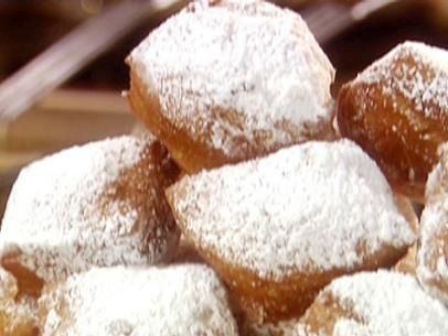 French Quarter Beignets Ingredients: 1 1/2 cups lukewarm water 1/2 cup granulated sugar 1 envelope active dry yeast 2 eggs, slightly beaten 1 1/4 teaspoons salt 1 cup evaporated milk 7 cups bread flour 1/4 cup shortening Nonstick spray Oil, for deep-frying 3 cups confectioners' sugar  Read more at: http://www.foodnetwork.com/recipes/paula-deen/french-quarter-beignets-recipe.html?oc=linkback