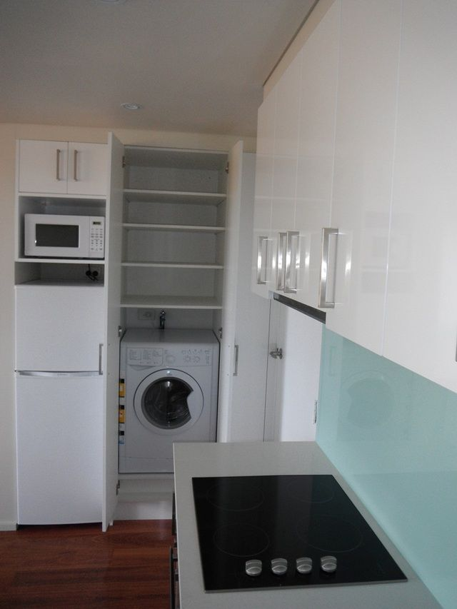 Small kitchens do double duty with a concealed laundry area. Custom Flatpack
