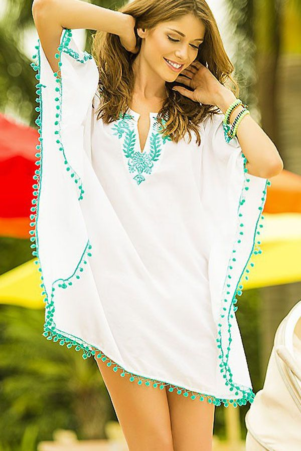 HisandHerFashion White Pompom Trim Embroidered Chiffon Caftan is as beautiful, cheerful and spirited as their other designs. The crisp white color is perfect for any warm destination and is much more