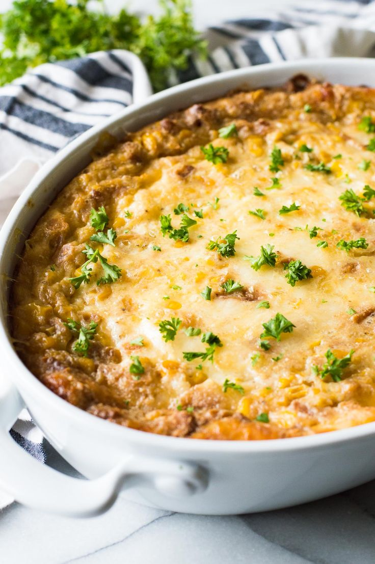Cheesy Corn Casserole. This EASY classic casserole dish is a must make for Thanksgiving or any holiday. Loaded with cheese, buttery crackers and corn this will quickly become a family favorite!