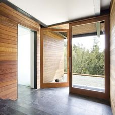 modern entry by Quezada Architecture.  White ceiling adds depth