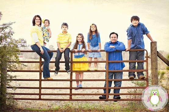 Family photos on gate.