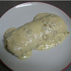 Similar to Mexican Restaurant White Sour Cream Cheese Sauce over a Chicken Burrito Allrecipes.com