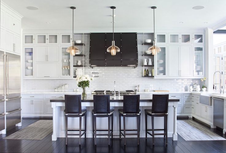 Black And White Kitchen Features Crisp White Cabinets