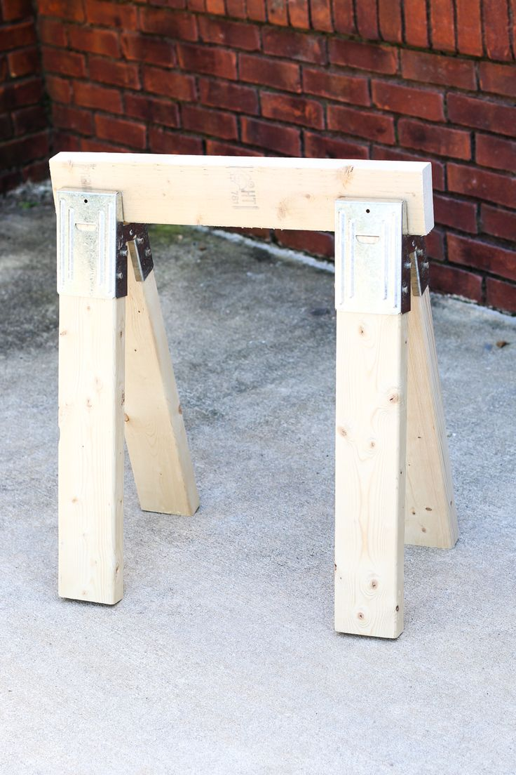 Learn how to build your own easy DIY sawhorse from scrap wood and $6 metal…