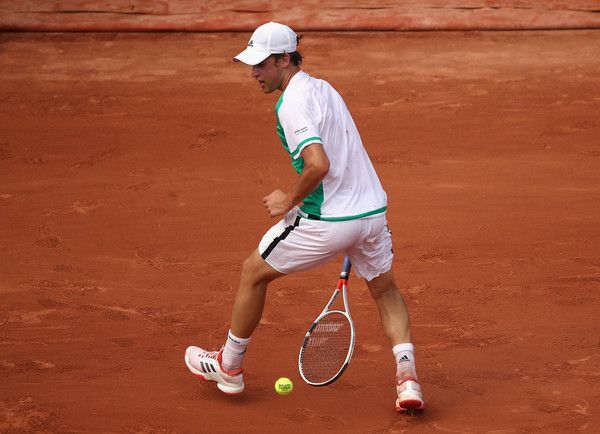 Dominic Thiem Photos Photos - Dominic Thiem of Austria returns the ball through his legs during the mens singles first round match against Bernard Tomic of Australia on day one of the 2017 French Open at Roland Garros on May 28, 2017 in Paris, France. - 2017 French Open - Day One