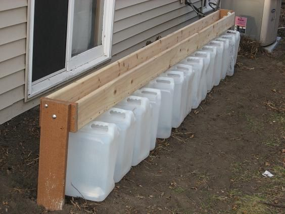 "Gutterless Rain Barrel – a ""Drain Barrel"" for those of you who may not have gutters on your house.  This project is most useful for those of us who have a clearly-defined gouge in our wood chips where the water pours off the roof. This would be also great to remember if you build a more permanent survival shelter…. Or at your bug out location"