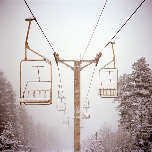 Snowy chair lifts.