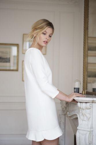 Beautiful white dress with ruffle hem