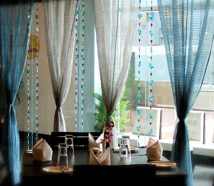 beautiful dining room with curtains of beads