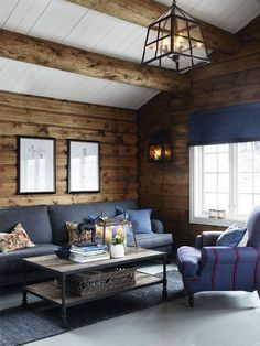 Massive ceiling timbers, log walls, white painted floors with plenty of fresh sunlight all add up to a complete Norwegian log cabin delight.