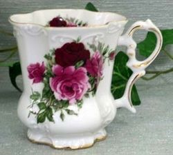 Fielder Keepsakes Summertime rose Victorian Mugs - Set of 2.    10 ounce capacity, hand painted and decorated in the USA.    not recommended for dishwasher use due to the gold embellishments.