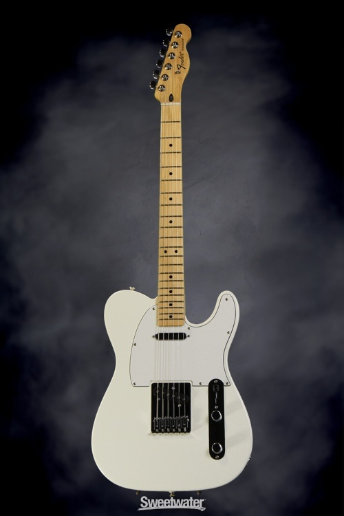 Mmm. Mm. Mm. Mm. Fender Standard Telecaster, love the white on white body with maple neck; only a couple weeks away from getting a Tele, and this is probably what it will look like. Simple. Beautiful. Impeccable tone.