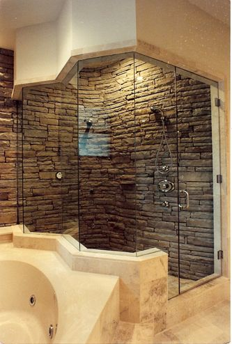 stacked stone shower with dual shower heads