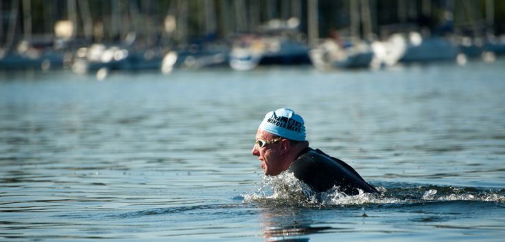 """Open Water Swimming:  Thousands of people now take a plunge in the lakes, tarns and rivers every year. The """"be keen to be seen"""" message follows negotiations between groups of lake users."""