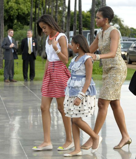 The First Lady walks alongside daughters Malia and Sasha upon arrival for a reception hosted by Brazilian President Dilma Rousseff at the Palacio do Alvorada, the official residence in Brasilia, Brazil in March 2011