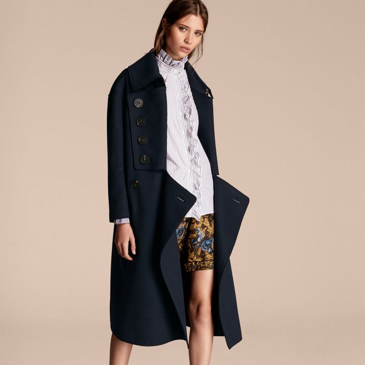 A longline-silhouette Burberry coat cut slightly oversize with a notched, draped front. The timeless design is crafted from noble military wool for a graceful drape, and is lined in smooth satin for effortless layering.