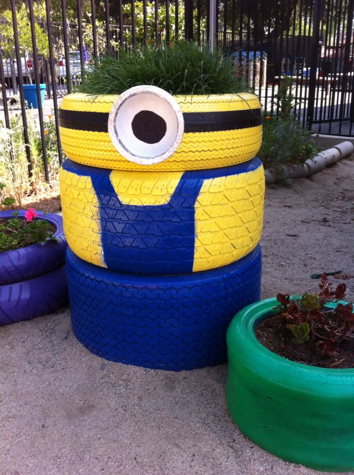 Our tire planter minion on the playground is finally for Using tyres as planters