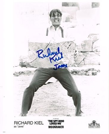 Richard Kiel (Jaws - James Bond) Authentic Signed 8x10 Autograph Photo - Hand-signed autograph with Certificate of Authenticity included. All orders are shipped within 48 hours. Free domestic shipping. Lifetime guarantee under the terms of our return policy. This signed item would make an excellent and unique gift. We have a wide variety of authentic 'James Bond' single and cast signed photographs available. Kiel played the role of the steel-toothed Jaws in the James Bond movies The Spy Who…