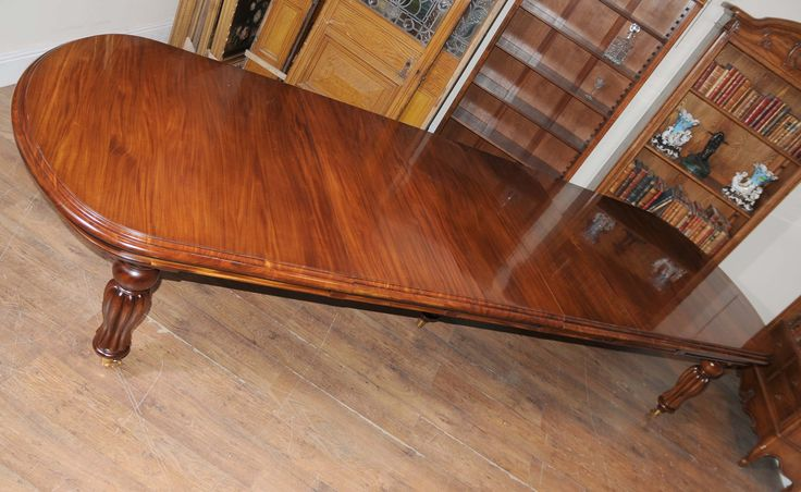 http://canonburyantiques.com/s/dining-tables/victorian-dining-tables/1/  Gorgeous large Victorian table in mahogany. This Victorian table extends via the leaf system...