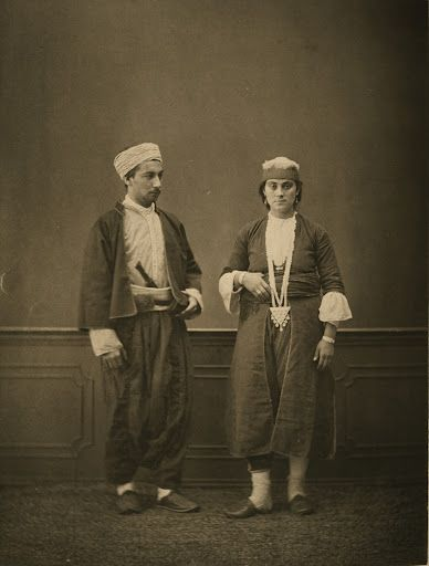 Studio portrait of models wearing traditional clothing 1873 photogravure. (1) Muslim of Lebanon; (2) Muslim woman of Lebanon. from the province of Surı̈yè (Syria), Ottoman Empire by Pascal Sabah bestpicturesof