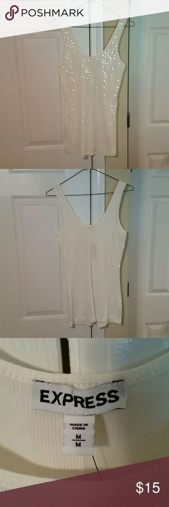 Express White Sequin Tank Top Size M An Express White Sequin Tank Top Size M. NWT. Nice top to wear with a blazer or on a night out in the town. Email me if interested. Thanks! Express Tops Tank Tops