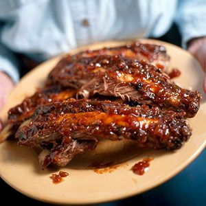 The slightly sweet grilling sauce gives a Texas twist to these back ribs. As is customary in the Lone Star State, most of the cooking is done before the sauce is slathered on. Be generous with the slathering, and be ready to serve more of the sauce on the side.