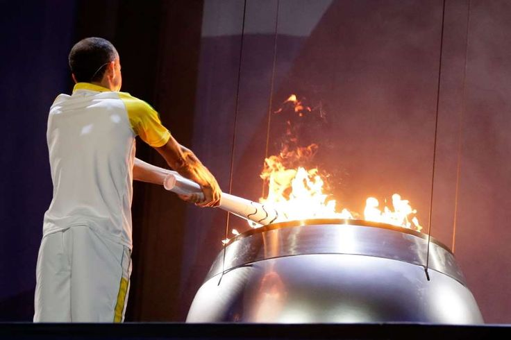 Rio Games begin with mix of pride, apathy, protests  -      Former athlete Vanderlei de Lima lights the Olympic Cauldron during the Opening Ceremony of the Rio 2016 Olympic Games at Maracana Stadium on August 5, 2016 in Rio de Janeiro, Brazil.