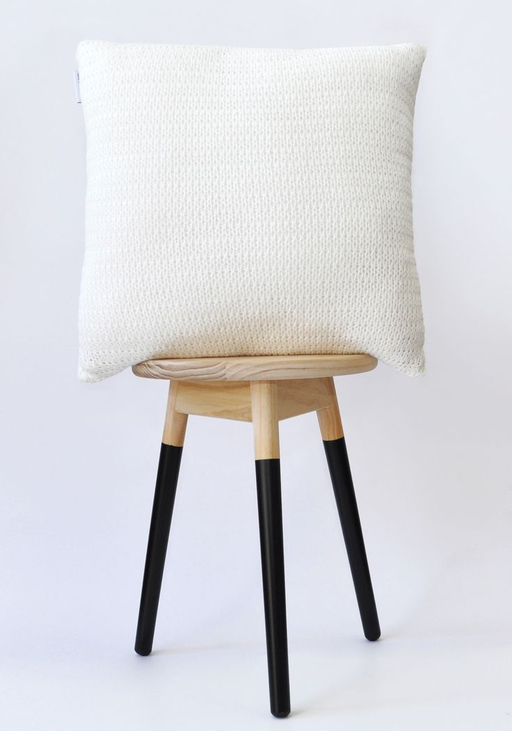 White knitted cushion cover.