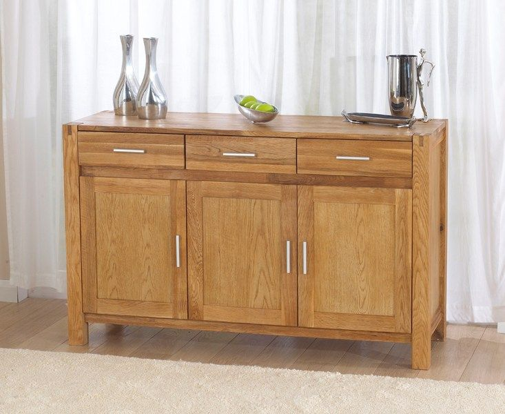 The Virginia 140cm Solid Oak Sideboard is stylish, practical and perfect for any home. Featuring three drawers and a three door cupboard with adjustable shelves, the oak sideboard is a wonderful asset for your dining room or living area.  Crafted from solid oak and veneer inserts, the 140cm sideboard is finished with a gentle coating of oil for a beautifully smooth finish. The oak sideboard is supplied with both oak and chrome handles, providing the perfect finishing touch fo